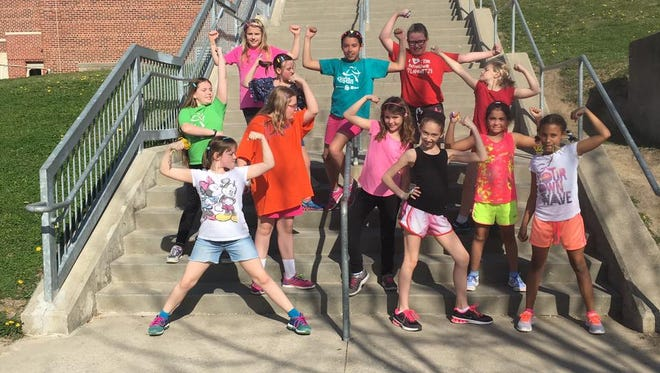 A Windsor Elementary Girls on the Run team strikes power poses during practice in March. The nonprofit group is part of the Give Local Des Moines project.