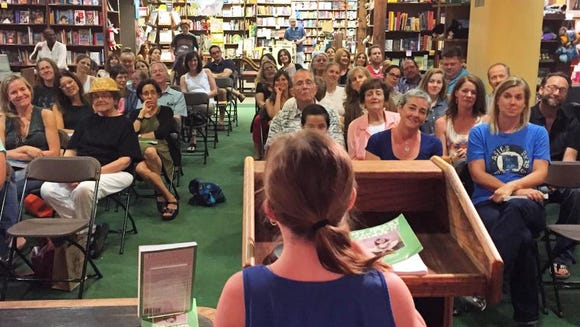 Sophie speaks during her mom Amy Silverman's reading