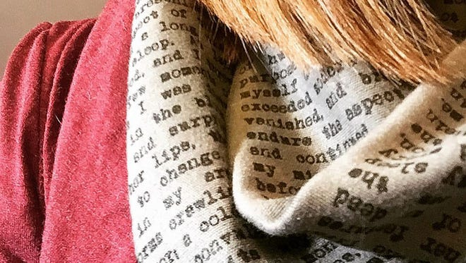 """This scarf, featuring selections of the novel """"Frankstein"""" by Mary Shelley, is one of Amy Bartner's picks. """"No, it's not a scarf with attached neck bolts. It's a thick, hand-sewn infinity scarf with text from the famous novel printed on it. And it looks like newsprint for nerdy newspaper employees."""" (Provided by Amy Bartner for Holiday Gift Guide 2016)"""