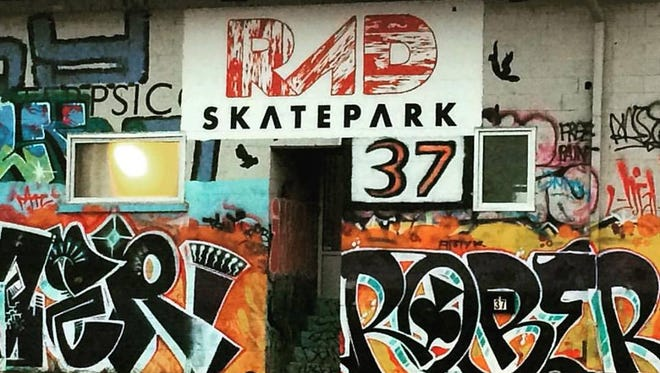 RAD Skatepark is colorfully tagged outside.