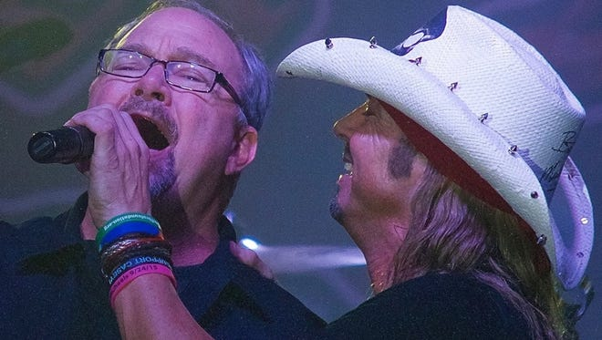 WAPL-FM morning show co-host Len Nelson, left, took Bret Michaels up on his offer to join him onstage for a KISS cover at last year's WAPL Xmas Bash.