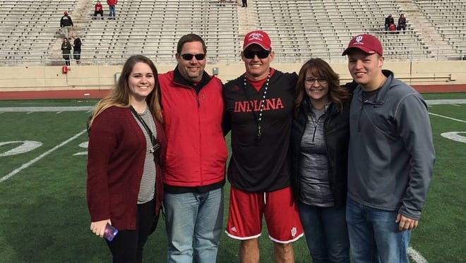 Todd Terrill, second from left, with daughter Caytlin Terrill, Tom Allen, wife Christy Terrill, and son Zachary Terrill  during a spring football game.