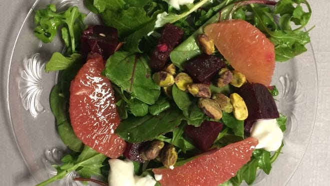 Tinker Street's arugula and frisee salad with roasted beets and goat cheese.
