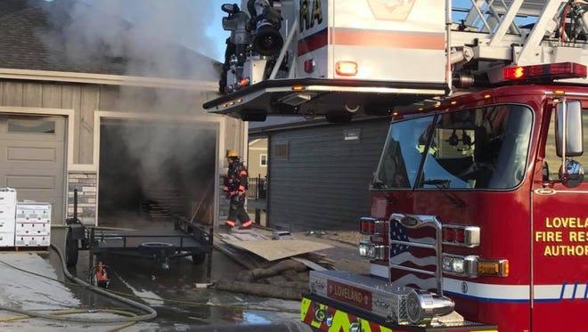 Firefighters battled a dumpster fire inside a garage Friday morning.