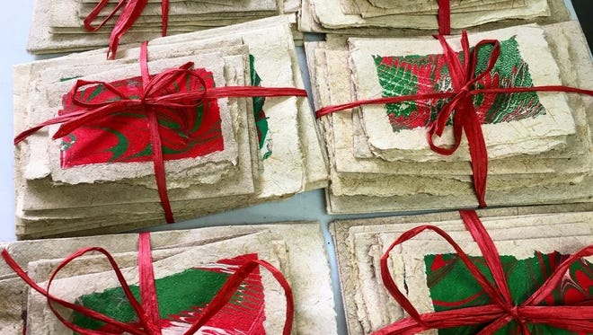 These beautiful holiday cards were made in Haiti from handmade paper, but the finishing touches are made locally by volunteers with Haiti Partners. If you'd like to volunteer, contact Suzi James at 772-539-8521 or via email at hello@haitipartners.org.