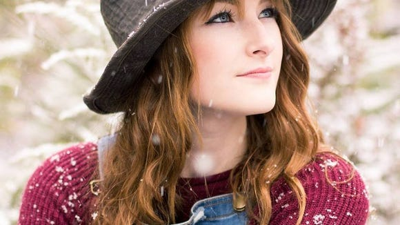 Afton Prater entertains June 15 at the Dugout Sports Bar & Grill in Bremerton.