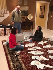 Dr. Lee Wagmeister watches as Rebecca Wonning and Melissa Bradley ready equipment and medication they will be taking to the Dominican Republic.
