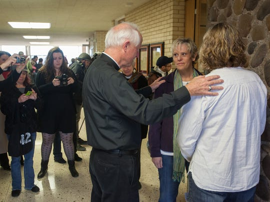 The Rev. Dr. Douglas Gregg performs a marriage ceremony for Angela Hinton and Michele Poast on Dec. 23, 2013, at the Washington County Administration Building after same-sex marriage was temporarily legalized in Utah. Their family is now facing changes in policy for same-sex marriage families in the LDS Church.