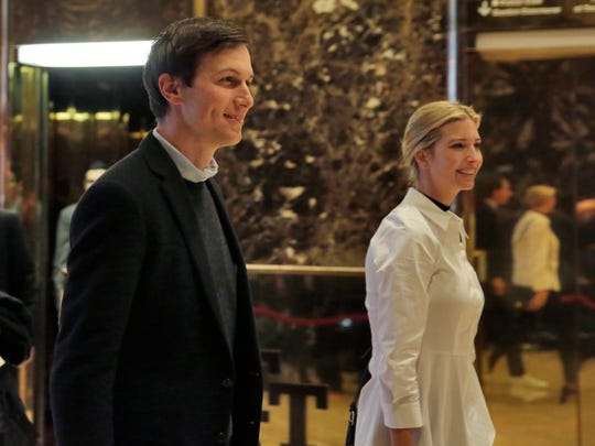 Jared Kushner and Ivanka Trump walk through the lobby