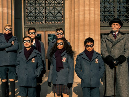 """Colm Feore (far right) plays an eccentric entrepreneur who raises a group of kid crimefighters in """"The Umbrella Academy."""""""