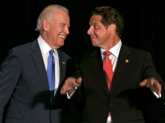 Vice President Joe Biden, left, and New York Gov. Andrew Cuomo, acknowledge applause at the Association for a Better New York luncheon, in New York,  July 27, 2015.