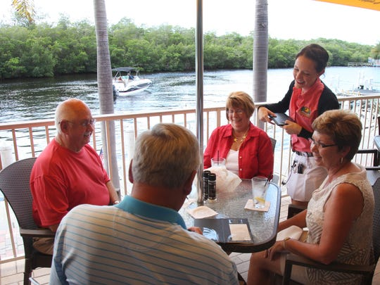 Watch the boats go by as you enjoy waterfront dining at Rumrunners in Cape Coral.