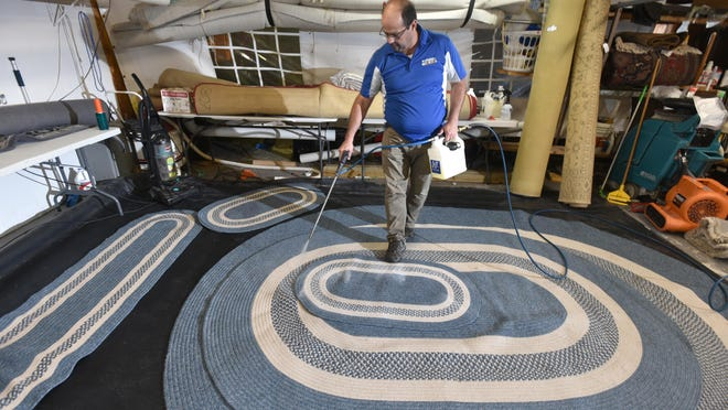 Alex DaCunha cleans wool rugs at his business on Fruean Avenue in South Yarmouth. Sixteen years after he started his company, DaCunha says he is busier than ever, even in the midst of the COVID-19 pandemic.
