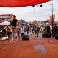 Comedian Tricia Chamberlain talks to the crowd at the Michigan Pride Festival Saturday, Aug. 27, 2016, in Lansing's REO Town.