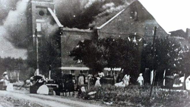 FILE - In this 1921 file image provided by the Greenwood Cultural Center via Tulsa World, Mt. Zion Baptist Church burns after being torched by white mobs during the 1921 Tulsa massacre. Black community and political leaders called on President Donald Trump to at least change the Juneteenth date for a rally kicking off his return to public campaigning, saying Thursday, June 11, 2020.