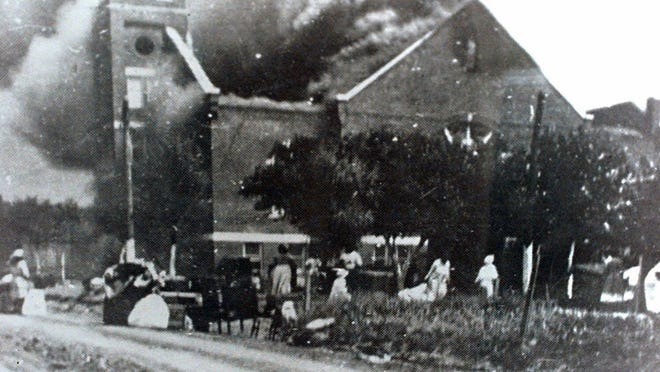 Mt. Zion Baptist Church burns after being torched by white mobs during the 1921 Tulsa race riot.