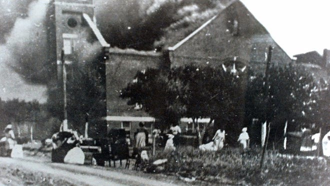 In this 1921 file image provided by the Greenwood Cultural Center via Tulsa World, Mt. Zion Baptist Church burns after being torched by white mobs during the 1921 Tulsa massacre. Black community and political leaders called on President Donald Trump to at least change the Juneteenth date for a rally kicking off his return to public campaigning, saying Thursday, June 11, 2020. From Sen. Kamala Harris of California to Tulsa civic officials, black leaders said it was offensive for Trump to pick that date - June 19 - and that place - Tulsa, an Oklahoma city that in 1921 was the site of a fiery and orchestrated white-on-black killing spree.