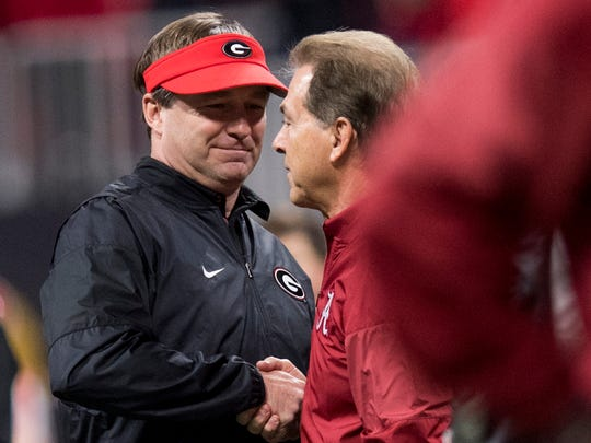 Georgia head coach Kirby Smart and Alabama head coach Nick Saban greet at midfield before the College Football Playoff National Championship Game in the Mercedes Benz Stadium in Atlanta, Ga., on Monday January 8, 2018. (Mickey Welsh / Montgomery Advertiser)