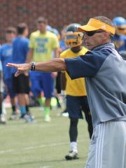 Walnut Hills head coach George Kontsis directs the Eagles in a 7-on-7 drill against Northwest July 29.