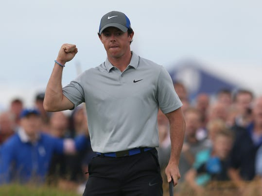 Rory McIlroy of Northern Ireland celebrates after playing an eagle on the 16th hole during the third day of the British Open Golf championship at the Royal Liverpool golf club, Hoylake, England, Saturday July 19, 2014. (AP Photo/Jon Super)