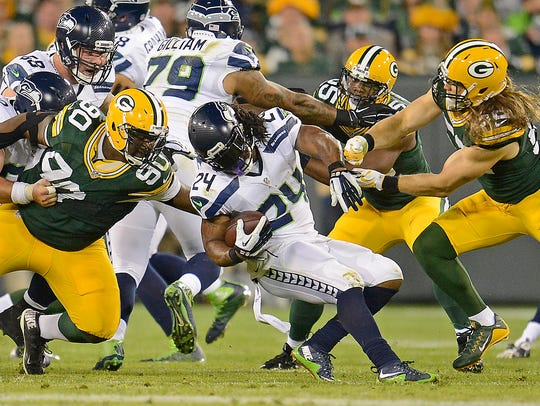 Green Bay Packers nose tackle B.J. Raji (90) and inside