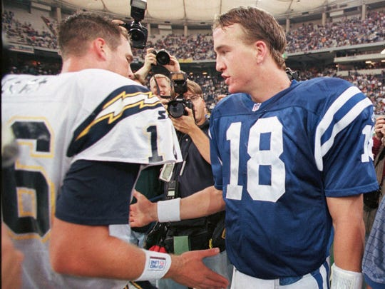 Colts quarterback Peyton Manning, right, and Chargers