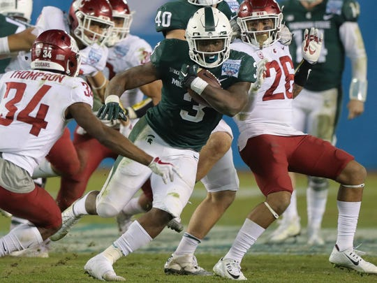 Michigan State running back LJ Scott runs the ball during the fourth quarter of MSU's 42-17 win over Washington State in the San Diego County Credit Union Holiday Bowl on Thursday, Dec. 28, 2017, in San Diego.