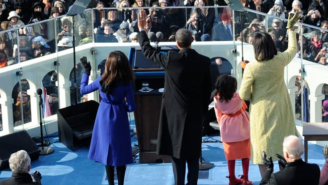 The Obamas wave from the West Front of the Capitol on Jan. 20, 2009.