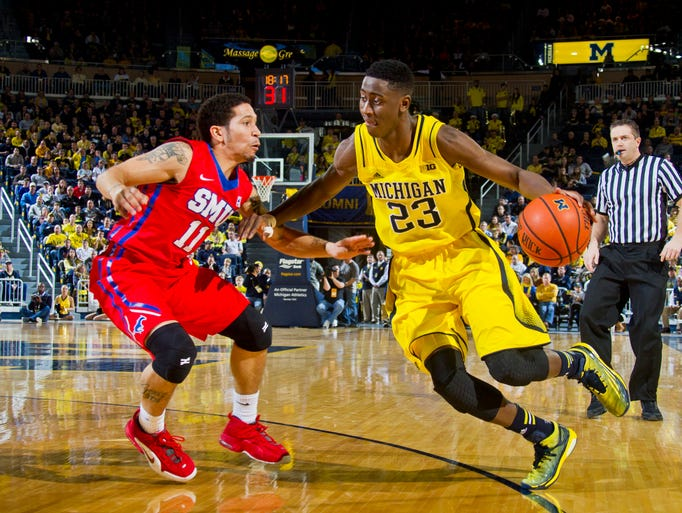 Southern Methodist guard Nic Moore (11) defends Michigan
