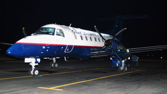 In this Nov. 1, 2010, file photo, a Great Lakes Airlines aircraft is seen at the Havre City-County Airport in Havre, Mont.