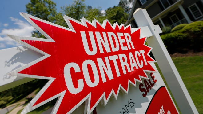 FILE - In this Tuesday, May 16, 2017, file photo, a sign advertises that an existing home for sale is under contract in Roswell, Ga. On Thursday, Nov. 2, 2017, Freddie Mac reports on the week's average U.S. mortgage rates. (AP Photo/John Bazemore, File) ORG XMIT: NYBZ430