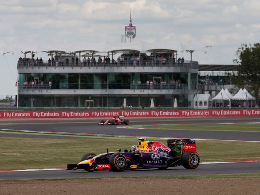 FILE - In this file photo dated Friday, July 4, 2014, Australia's Daniel Riccardo of Red Bull rounds the track during a practice session before the British Formula One Grand Prix at Silverstone circuit, Silverstone, England. Ricciardo can challenge the best when he's on form and may be entering his prime years. (AP Photo/Jon Super, FILE)