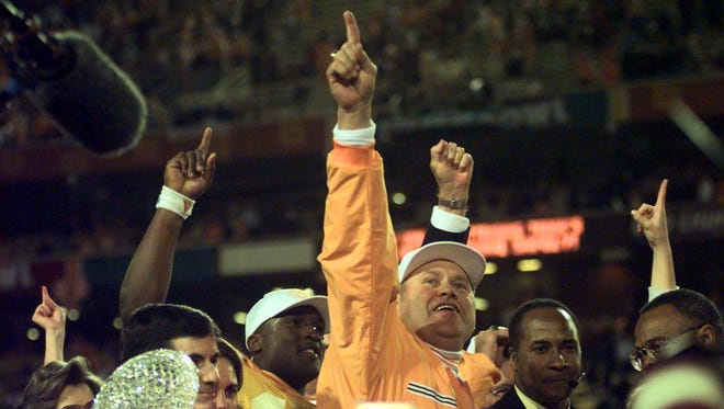 Tennessee head coach Phillip Fulmer celebrates winning the National Championship after defeating Florida State in Tempe, Ariz. Quarterback Tee Martin is behind him.