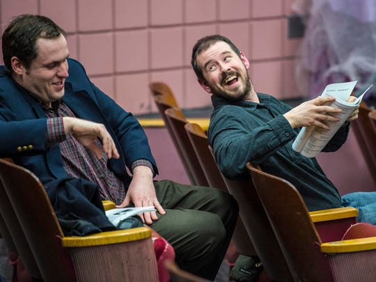 City Councilors Brian Sweeney, right, and Seth Leonard share a laugh before the start of the Winooski town meeting at the Winooski Educational Center on Monday.