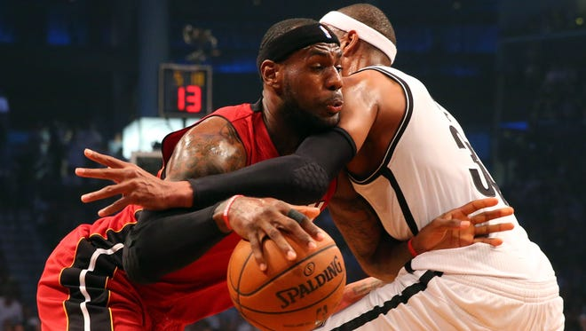 Miami's LeBron James, left, drives against Brooklyn's Paul Pierce in the first quarter on Monday.