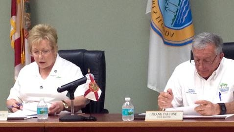 Palm Shores Mayor Carol McCormack listens as Vice Mayor Frank Falcone introduces an ordinance related to disbanding the town's community redevelopment agency and repayment of money to Brevard County during a July 5 special meeting of the Palm Shores Town Council.