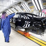 The new 2015 Chrysler 200 is shown in the Paint shop at the Sterling Heights Assembly Plant March 14, 2014 in Sterling Heights, Michigan.  (Photo by Bill Pugliano/Getty Images)