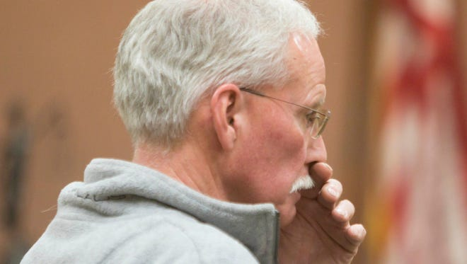 In this Monday, April 9, 2018 photo, Keith Huck listens during his sentencing hearing in Howell, Mich. Huck, charged with animal cruelty after about 70 cows were found dead on his properties, was sentenced to 15 days in jail and ordered to pay nearly $20,000 in restitution.
