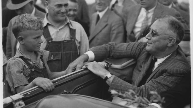 """As seen in """"The Roosevelts: An Intimate History,"""" President Franklin Delano Roosevelt greets drought-stricken farmers in North Dakota, 1936."""