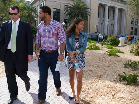 Nate Allen and his lawyer Sawyer Smith leave the county courthouse in downtown Fort Myers after holding a press conference discussing Allen's arrest. Allen, who has been cleared of any wrongdoing by police and the state attorney's office, said he's glad the situation with a false accusation is over but that he's heard of similar situations.