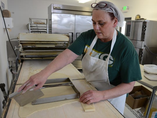 Olde World Pastries Plus owner Glenda Blazek prepares dough for kringles at the new shop at 1770 East Deerfield Avenue in Howard.