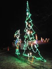 A light-up child decorates a light-up tree at Winter WonderFest at Cape Henlopen State Park.