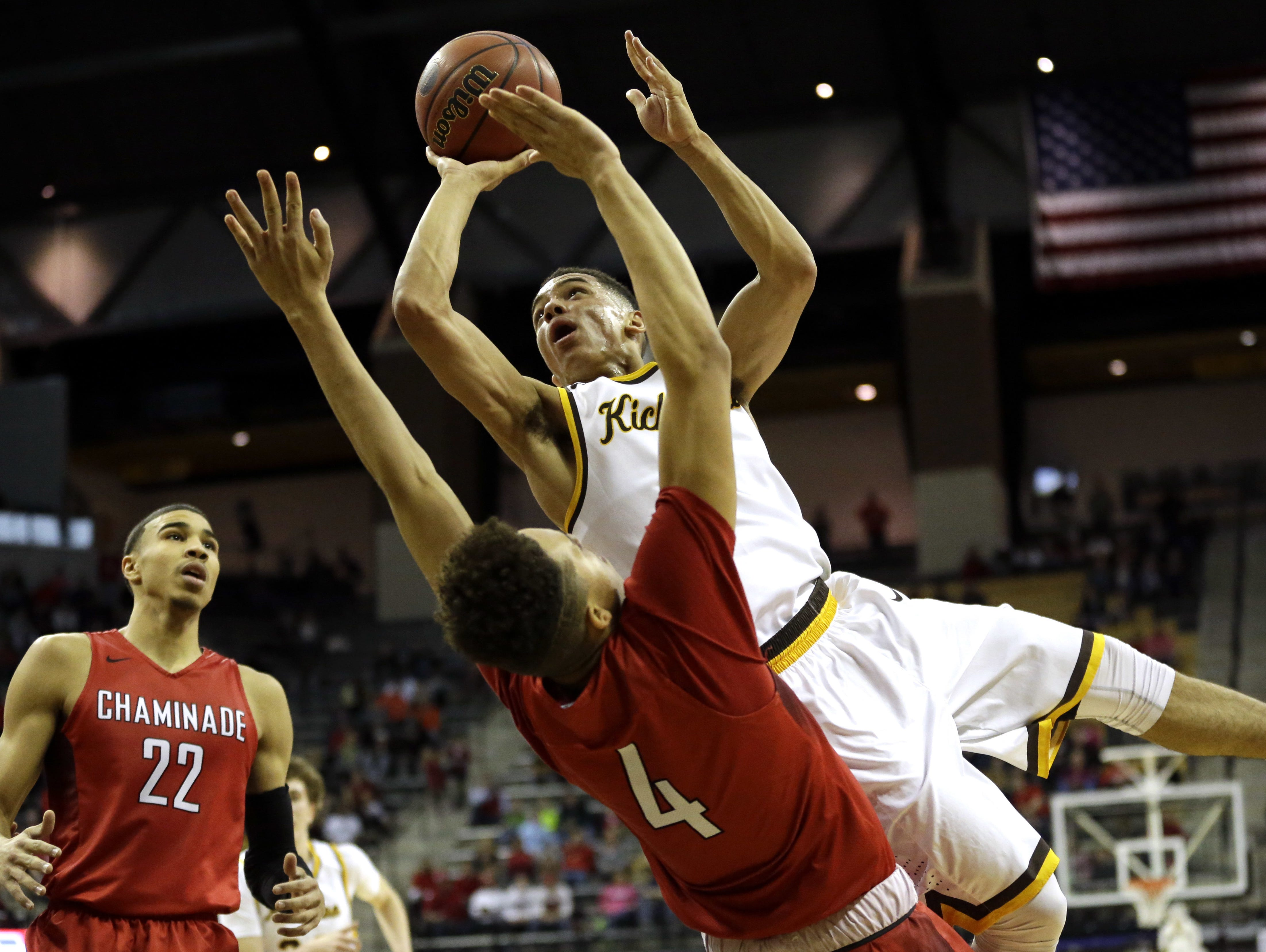 Kickapoo junior Cameron Davis, top center, is fouled on his way to the basket by Chaminade's Jericole Hellems (4) as Chaminade's Jayson Tatum (22) watches during the second half of the Missouri Class 5 boys' high school championship game in Columbia.
