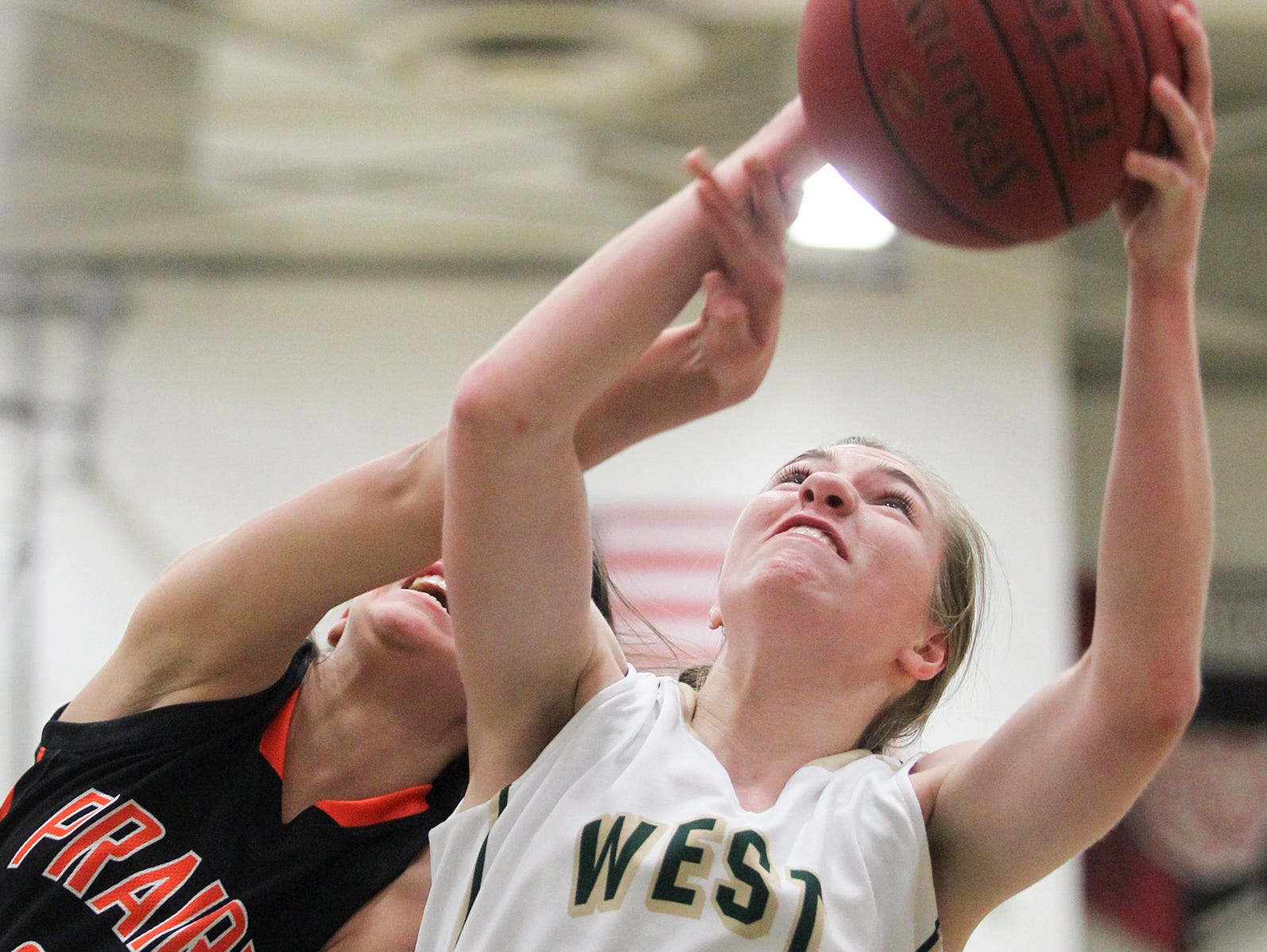 West High's Ali Tauchen fights for a rebound during the Women of Troy's game against Cedar Rapids Prairie on Tuesday, Dec. 1, 2015.