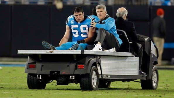 FILE - In this Nov. 17, 2016, file photo, Carolina Panthers' Luke Kuechly (59) is taken off the field after being injured in the second half of an NFL football game against the New Orleans Saints, in Charlotte, N.C.  Five Panthers players are in the NFL concussion protocol, including former NFL Defensive Player of the Year Luke Kuechly.  (AP Photo/Bob Leverone, File)