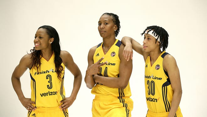 Indiana Fever forward Tamika Catchings (24) flashes the peace sign as she poses for a photo with guard Brene Moseley (30) and guard Tiffany Mitchell (3) May 9, 2016, at Bankers Life Fieldhouse.