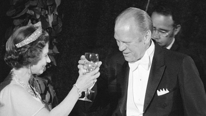 President Ford with wife Betty toasts Queen Elizabeth II following a state dinner at the White House on July 7, 1975.