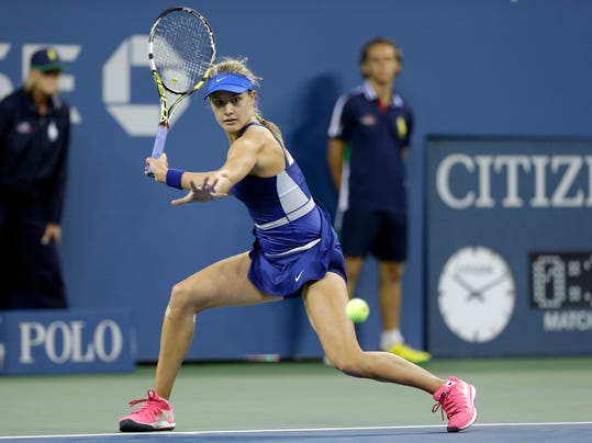 Eugenie Bouchard, of Canada, returns a shot to Sorana Cirstea, of Romania, during the second round of the 2014 U.S. Open tennis tournament Thursday, Aug. 28, 2014, in New York. (AP Photo/Darron Cummings)