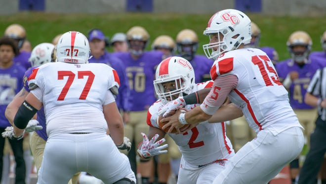 Olivet's Damorria Lily (2) takes a hand off from Braden Black (15) against Albion College on Oct. 15.