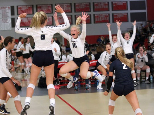 Molly Howe (10), Jenny O'Keefe (8) and Rylee Vaughn (2) celebrate a point with their teammates at The Joust hosted at Homestead High School on Aug. 26.